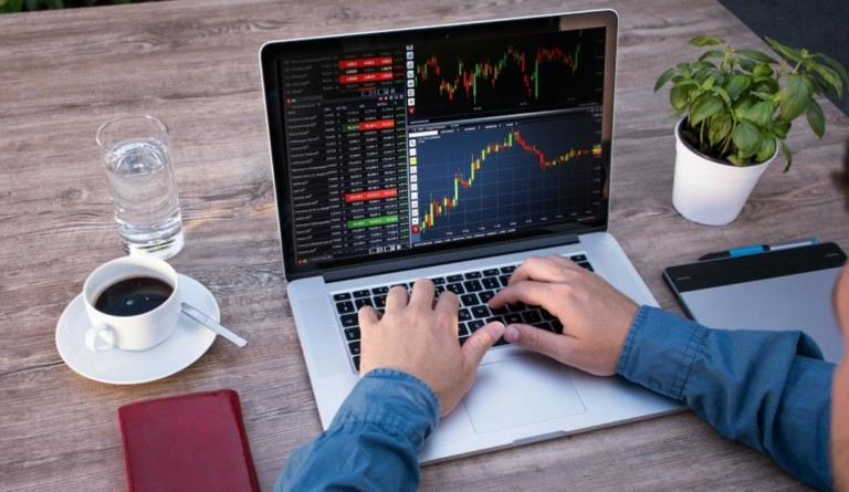 stock charts on a laptop